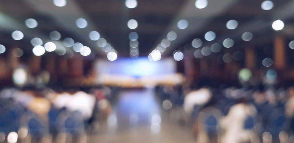 Blurred Audience Watching Presentation